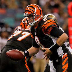2009 August 14: Cincinnati Bengals quarterback Carson Palmer (9) looks to handoff during a preseason opener between the Cincinnati Bengals and the New Orleans Saints at the Louisiana Superdome in New Orleans, Louisiana.