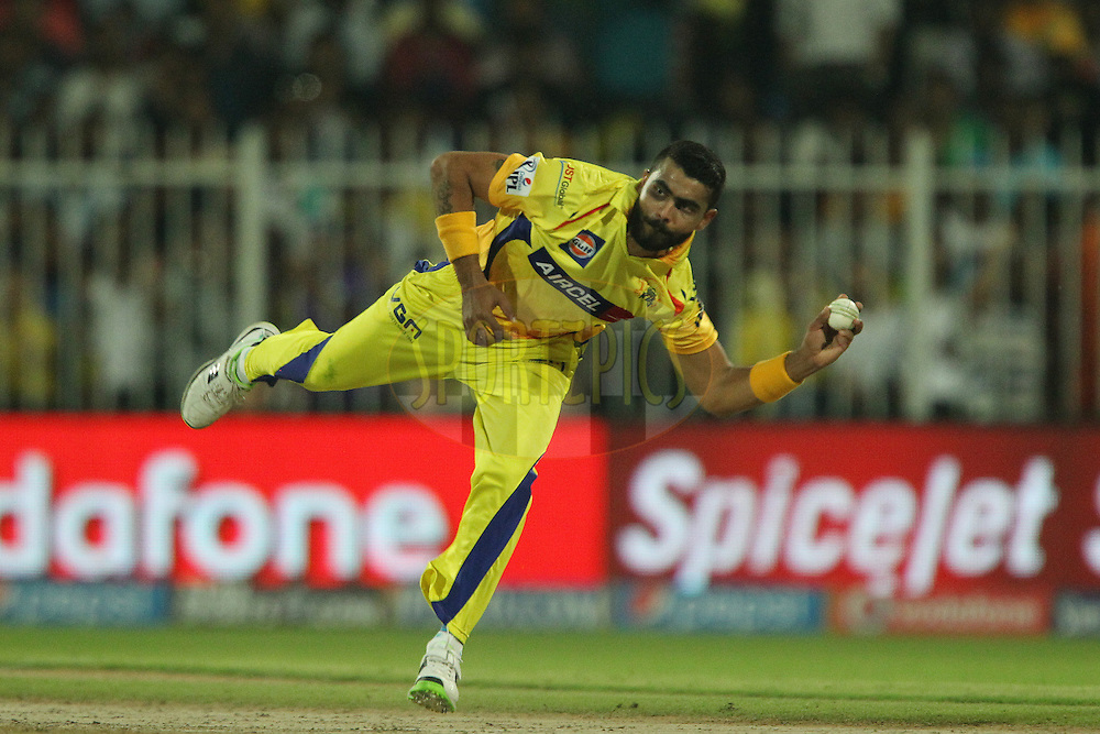 Ravindra Jadeja of The Chennai Superkings throws the ball in for the attempted run out during match 17 of the Pepsi Indian Premier League 2014 between the Sunrisers Hyderabad and the Chennai Superkings held at the Sharjah Cricket Stadium, Sharjah, United Arab Emirates on the 27th April 2014<br /> <br /> Photo by Ron Gaunt / IPL / SPORTZPICS