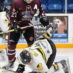 "TRENTON, ON  - MAY 3,  2017: Canadian Junior Hockey League, Central Canadian Jr. ""A"" Championship. The Dudley Hewitt Cup. Game 3 between the Powassan Voodoos and the Dryden GM Ice Dogs.  Nic Noseworthy #27 of the Dryden GM Ice Dogs  mass the hit on  Cameron Moore #4 of the Powassan Voodoos during the first period <br /> (Photo by Amy Deroche / OJHL Images)"