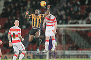 JJ Hooper (Port Vale) jumps with Luke McCulloch (Doncaster Rovers) during the Sky Bet League 1 match between Doncaster Rovers and Port Vale at the Keepmoat Stadium, Doncaster, England on 26 January 2016. Photo by Mark P Doherty.
