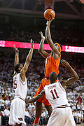 FAYETTEVILLE, AR - NOVEMBER 30:  C.J. Fair #5 of the Syracuse Orangemen shoots over Anthlon Bell #5 and BJ Young #11 of the Arkansas Razorbacks at Bud Walton Arena on November 30, 2012 in Fayetteville, Arkansas.  The Orangemen defeated the Razorbacks 91-82.  (Photo by Wesley Hitt/Getty Images) *** Local Caption *** C.J. Fair; Anthlon Bell; BJ Young