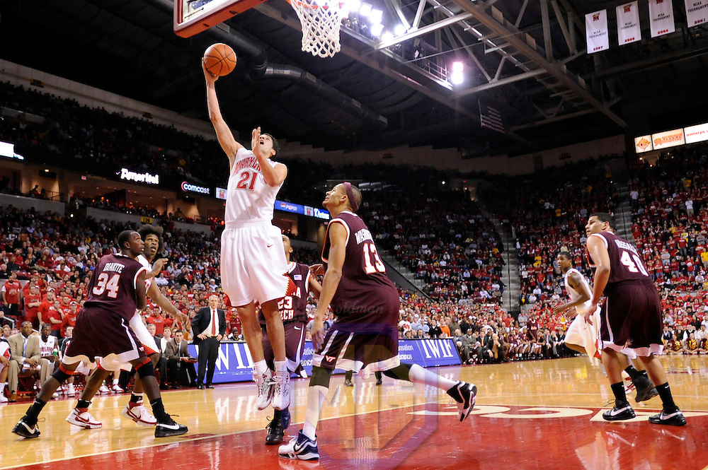 20 February 2008:   Maryland guard Greivis Vasquez (21) scores 2 of his game high 25 points against Virginia Tech guard/forward Deron Washington (13) in the 2nd half at the Comcast Center in College Park, Maryland.  The Virginia Tech Hokies defeated the University of Maryland Terrapins 69-65.