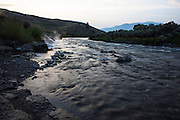 Where Boiling River meets the Gardner River, Yellowstone National Park, Wyoming, close to the 45th parallel, halfway between the equator and the North Pole. At Boiling River, hot springs mix with the icy cold water of the Gardner, providing a unique experience for bathers, who have the strange sensation of one foot numb with cold from the mountains, while the other is almost scalded by the thermal spring water.<br /> <br /> The Gardner is a tributary of the Yellowstone River - this image was taken close to its confluence with the larger river.