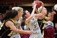 College of Southern Idaho's Holly Checketts tries to knock away the ball from a rebounding Amanda Carlton from North Idaho College during the second half Saturday of CSI's loss to the Cardinals 76-49 in Coeur d'Alene.