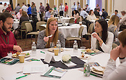 Kim Daniels, middle, of Youngstown, Ohio, talks to Ray Mercer, left, of Lawrenceburg, Ind., and Maikhank Nguyen, right, of Dayton, Ohio during lunch at the College of Business Center for Leadership Event on April 23, 2016.
