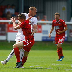 Dovers defender Tim Schmoll and Wrexhams midfielder Luke Young clash mid field during the opening National League match between Dover Athletic and Wrexham FC at Crabble Stadium, Kent on 04 August 2018. Photo by Matt Bristow.