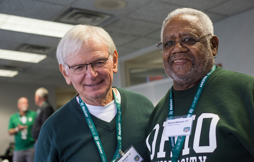 Larry Conrath, left, and Chuck Williams, who both graduated from Ohio University in '67, pose for a picture before the football game against the Hampton Pirates on Sept. 2, 2017 in the Presidents box at Peden Stadium. Conrath and Williams have remained friends over the years.