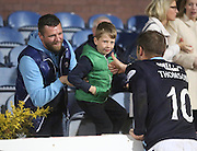 Dundee captain Kevin Thomson gives his captain's armband to a young fan after his side had won the derby - Dundee v Dundee United - SPFL Premiership at Dens Park<br /> <br />  - &copy; David Young - www.davidyoungphoto.co.uk - email: davidyoungphoto@gmail.com
