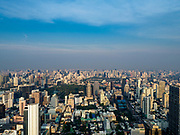 27 DECEMBER 2018 - BANGKOK, THAILAND:  Looking northeast from the rooftop observation deck of the King Power Maha Nakhon Tower. The green space in the center of the frame is Lumpini Park. The MahaNakhon Skywalk, at the top of the King Power Maha Nakhon Tower, is 1,030 feet (314 meters) above street level. It is the tallest building and highest vantage point in Bangkok. The skywalk opened in November and has been drawing large crowds.     PHOTO BY JACK KURTZ