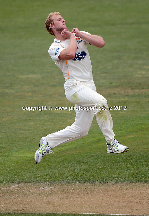 Wellington's Harry Boam bowling. Plunket Shield Cricket, Auckland Aces v Wellington Firebirds at Eden Park Outer Oval. Auckland on Wednesday 28 November 2012. Photo: Andrew Cornaga/Photosport.co.nz