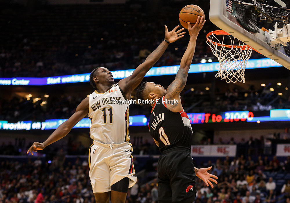 Mar 27, 2018; New Orleans, LA, USA; New Orleans Pelicans guard Jrue Holiday (11) goes up to block a shot by Portland Trail Blazers guard Damian Lillard (0) during the second half at the Smoothie King Center. The Trail Blazers defeated the Pelicans 107-103. Mandatory Credit: Derick E. Hingle-USA TODAY Sports