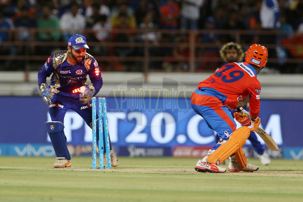 Parthiv Patel of the Mumbai Indians stumps out Dinesh Karthik of the Gujarat Lions during match 35 of the Vivo 2017 Indian Premier League between the Gujarat Lions and the Mumbai Indians  held at the Saurashtra Cricket Association Stadium in Rajkot, India on the 29th April 2017<br /> <br /> Photo by Vipin Pawar - Sportzpics - IPL