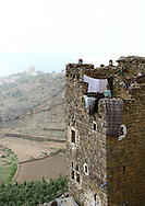 Al Hajjarah village, Jabal Haraz, Yemen. The stone houses in the mountains are like fortresses. Women have a their own floor specifically meant to welcome and entertain guests. <br />