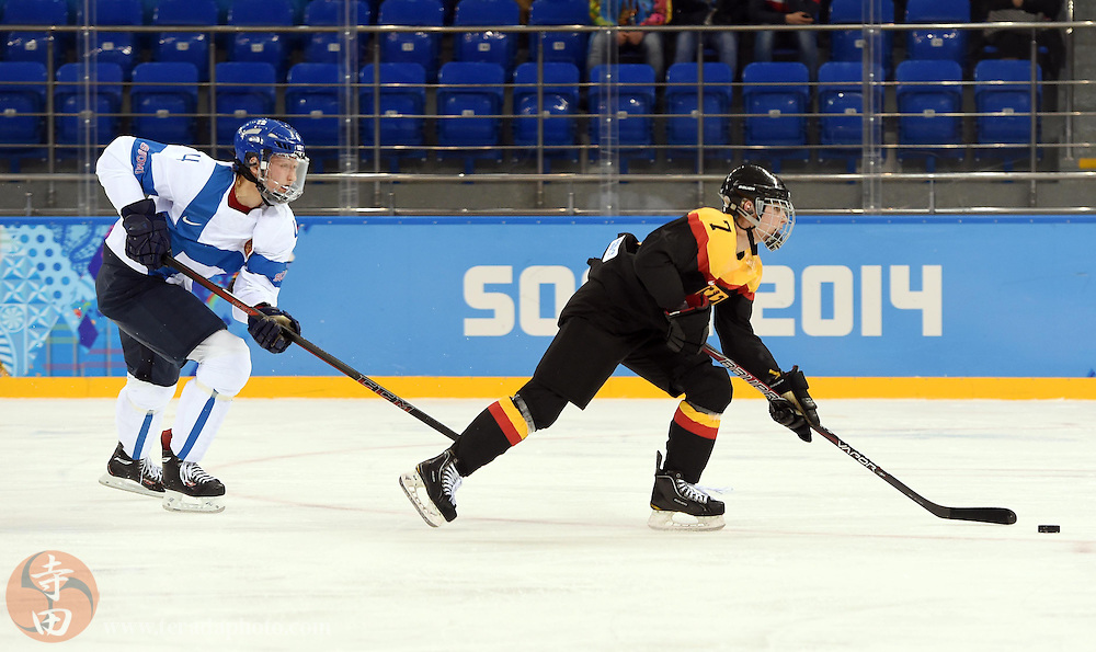 Feb 16, 2014; Sochi, RUSSIA; Germany forward Nina Kamenik (7) skates with the puck against Finland in the women's ice hockey classifications round during the Sochi 2014 Olympic Winter Games at Shayba Arena.