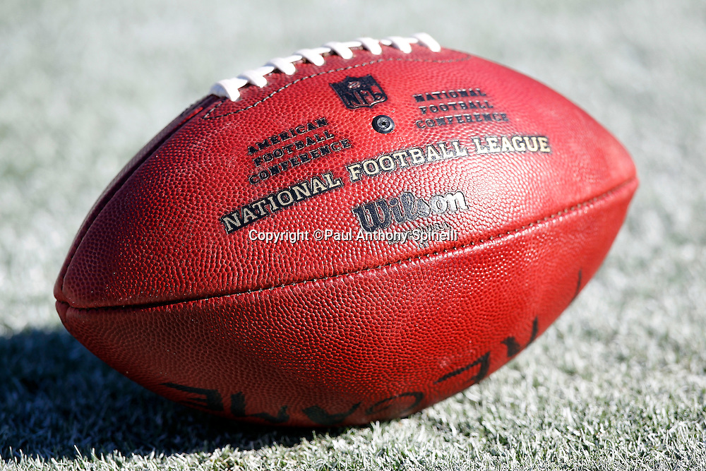 A football sits on the turf prior to the San Diego Chargers NFL week 1 preseason football game against the Chicago Bears, Saturday, August 14, 2010 in San Diego, California. The Chargers won the game 25-10. (©Paul Anthony Spinelli)