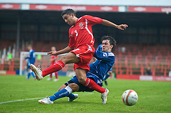 WREXHAM, WALES - Saturday, October 10, 2009: Wales' Neil Taylor and Bosnia-Herzegovina's Boris Savic during the UEFA Under-21 Championship Qualifying Round Group 3 match at the Racecourse Ground. (Pic by Chris Brunskill/Propaganda)