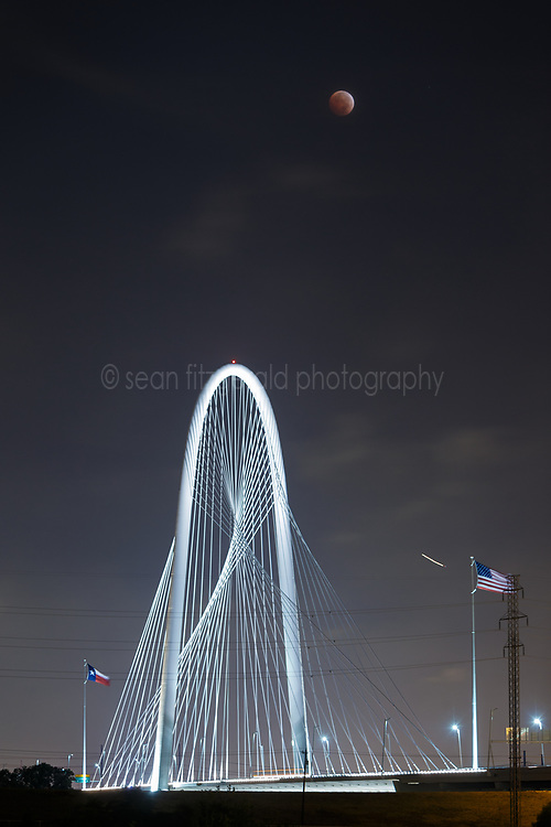 Total lunar eclipse and Margaret Hunt Hill Bridge, Dallas, Texas, USA