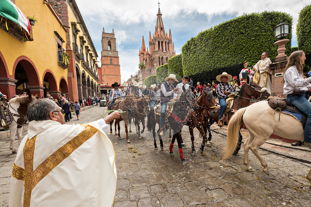 Mexican cowboys are sprinkled with holy water by Catholic priests blessing their pilgrimage during the festival of Saint Michael in San Miguel de Allende, Mexico.