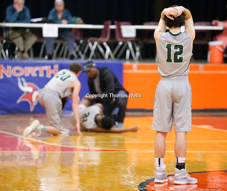 Thomas Wells | Buy at PHOTOS.DJOURNAL.COM<br /> Mooreville's Bo Thomas finds it hard to watch his teammate Cam Lockridge being treated for an ankle injury in the third period of their game against Hatley on Tuesday.