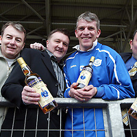 Jim Weir of St Johnstone FC who is in his testimonial year, pictured being presented with a special edition 'Captain's Choice' malt whisky to mark his ten years at the club. Pictured from left, Ian Duff, Testimonial Cttee, Hugh Taylor, Vice Chairman Testimonial Ctte, Jim Weir and Grant Scrimgeour of CJ Lang Food Services who have donated the whisky.<br />Picture by Graeme Hart.<br />Copyright Perthshire Picture Agency<br />Tel: 01738 623350  Mobile: 07990 594431