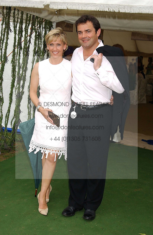 WILL CARLING and his wife LISA at the 2005 Cartier International Polo between England &amp; Australia held at Guards Polo Club, Smith's Lawn, Windsor Great Park, Berkshire on 24th July 2005.<br />
