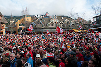 A crowd cheers in Village Square as Canada wins the gold medal hockey game between Canada and the USA on the big screen outdoor television during the 2010 Olympic Winter Games in Whistler, BC Canada.