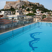 View of the Acropolis from the top of the Electra Palace Hotel in the Plaka neighborhood of Athens, Greece