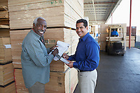 Manger and Worker on Loading Dock Checking Inventory