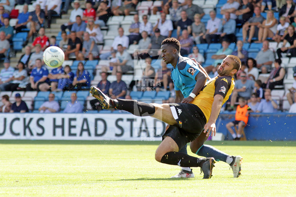 TELFORD COPYRIGHT MIKE SHERIDAN 4/8/2018 - Daniel Udoh battles for the ball with Ryan Astles during the National League North fixture between AFC Telford United and Southport FC.