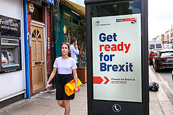 "© Licensed to London News Pictures. 01/09/2019. London, UK. A woman walks past the new ""Get ready for Brexit"" advert on a telephone box in north London. <br /> Today, the UK Government launches its £100m ""Prepare for Brexit"" advertising campaign to reassure the nation ahead of a potential no-deal departure from the European Union on 31 October. Photo credit: Dinendra Haria/LNP"