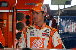 June 25, 2011; Sonoma, CA, USA;  Sprint Cup Series driver Joey Logano (20) stands in the garage before practice for the Toyota/Save Mart 350 at Infineon Raceway.