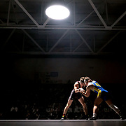 Genoa's Dustin Morgillo, left, gains control of Findlay's Max Jolliff while wrestling at 152 pounds during the in-school assembly wrestling dual between Genoa and Findlay at Genoa High School in Genoa, Ohio, on Thursday, December 20, 2018. The event was the debut of the new mat lamp. THE BLADE/KURT STEISS