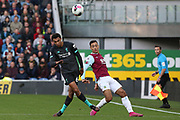 Liverpool defender Trent Alexander-Arnold (66) beats Burnley midfielder Dwight McNeil (11) during the Premier League match between Burnley and Liverpool at Turf Moor, Burnley, England on 31 August 2019.