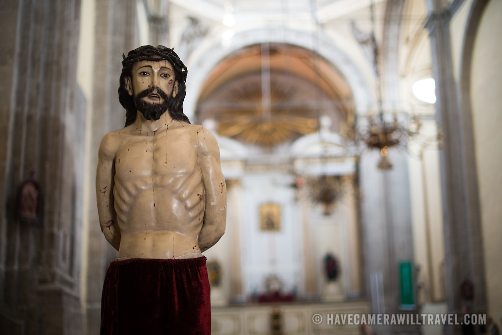 A statue of Jesus Christ in the nave of the Iglesia de la Santisima Trinidad in Mexico City, Mexico. Iglesia de la Santisima Trinidad translates as Church of the Holy Trinity.
