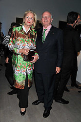 PETER & RENATE JUNGEN he is chairman Centre on Capitalism and Society, Columbia University, New York at Arts for Human Rights gala dinner in aid of The Bianca Jagger Human Rights Foundation in association with Swarovski held at Phillips de Pury & Company, Howick Place, London on 13th October 2011.
