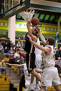 1/6/2006: Grant Assink of the Central Washington Wildcats gets fouled while going for two.  The University of Alaska-Anchorage defense held Assink to 13 points in the Seawolves victory over the visiting Central Washington Wildcats, 80-60 at the Wells Fargo Sports Complex on the campus of UAA.<br />