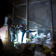 January 26, 2014 - Kiev, Ukraine: Ukrainian protesters laid siege to Ukrainian House international convention center, a Soviet-era building in central Kiev, used as a base by the security forces, who remained holed up inside.