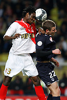 FOOTBALL - FRENCH CHAMPIONSHIP 2009/2010 - L1 - AS MONACO v GIRONDINS DE BORDEAUX - 13/03/2010 - PHOTO PHILIPPE LAURENSON / DPPI - NICOLAS NKOULOU NDOUBENA (ASM) / GREGORY SERTIC (BOR)