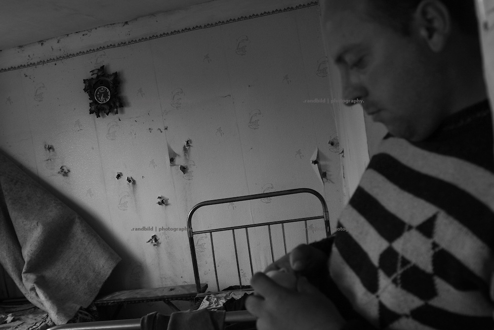 A villager at the frontline village Dizi in his house sevened by bullets. Dizi is located in the so called bufferzone between Gori and Tskhinvali, few days after the withdrawal of the russian forces from the area. The bufferzone was etablished after a short war in August 2008 as the georgian army assulted South Ossetia to overthrow the local separatist government.