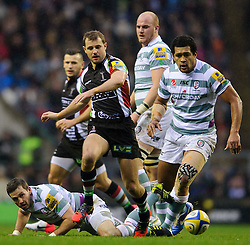 Harlequins Fly-Half (#10) Nick Evans and London Irish Number 8 (#8) Chris Hala'Ufia competes for a loose ball during the first half of the match - Photo mandatory by-line: Rogan Thomson/JMP - Tel: Mobile: 07966 386802 29/12/2012 - SPORT - RUGBY - Twickenham Stadium - London. Harlequins v London Irish - Aviva Premiership - LV= Big Game 5.
