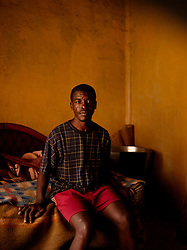 "Stephen Themba Hlophe, born in 1973, sits in his bedroom in a small house in Daveyton, South Africa. Stephen was very young when he became involved in the resistance and is known to have been a deadly, skilled fighter.  He went into exile in 1989 when it became too dangerous for him to remain in the country.  ""Im a very talented man. I want to understand why today I am like this,"" he says, referring to the fact that he has no job and can barely scrape together enough money for food."