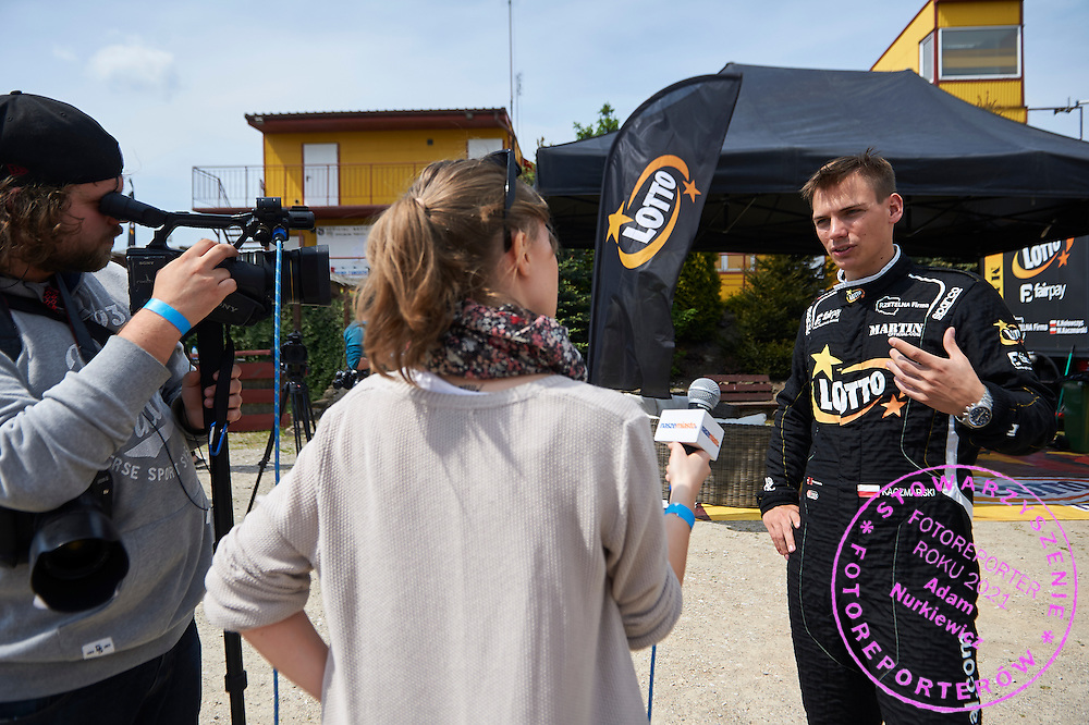Driver Martin Kaczmarski from Poland while tv interview during training session on rally cross track on May 19, 2015 in Slomczyn, Poland<br /> <br /> Poland, Slomczyn, May 19, 2015<br /> <br /> Picture also available in RAW (NEF) or TIFF format on special request.<br /> <br /> For editorial use only. Any commercial or promotional use requires permission.<br /> <br /> Adam Nurkiewicz declares that he has no rights to the image of people at the photographs of his authorship.<br /> <br /> Mandatory credit:<br /> Photo by &copy; Adam Nurkiewicz / Mediasport