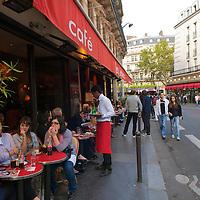 Parisian street scene outside of Cafe Restaurant Les Editeurs in the Saint Germain des Pres neighborhood.