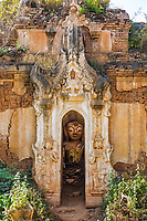 Buddha statue hiding in the ruins of the Shwe Inn Dein Pagoda at Inle Lake Shan state in Myanmar (Burma)
