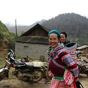 Visitor to the Lung Khau Nhin Market. Vietnam. Lung Khau Nhin Market is rural tribal market hiding itself amongst the mountains and forests of the far north Vietnam about 10 km from the border with China. The market plays an important role for the local ethnic people, Flower Hmong, Black Zao, Zay, and very small ethnic groups  Pa Zi, Tou Zi, Tou Lao. Tourist trips to the market run from Sapa and Lao Cai every week. Lung Khau Nhin Market, Vietnam.15th March 2012. Photo Tim Clayton