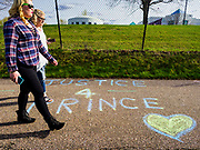 21 APRIL 2017 - CHANHASSEN, MN:  People walk on the footpath in front of Paisley Park, the former home and recording studio of Prince. The superstar died from an accidental overdose of the opioid fentanyl on April 21, 2016. Friday was the first anniversary of his death. Crowds of people gathered at Paisley Park, which is now a museum, to honor the Minnesota born musician.    PHOTO BY JACK KURTZ