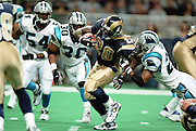 Defensive back Deon Grant (27) of the Carolina Panthers tries to tackle Running Back Marshall Faulk (28) of the St. Louis Rams during a 48 to 14 win by the Rams on 11/11/2001..©Wesley Hitt/NFL Photos