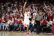 FAYETTEVILLE, AR - FEBRUARY 27:  Daryl Macon #4 of the Arkansas Razorbacks signals to the crowd after hitting a three pointer during a game against the Auburn Tigers at Bud Walton Arena on February 27, 2018 in Fayetteville, Arkansas.  The Razorbacks defeated the Tigers 91-82.  (Photo by Wesley Hitt/Getty Images) *** Local Caption *** Daryl Macon