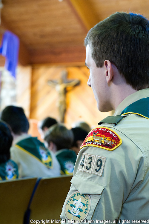6 Mar 2016 Brick, New Jersey US // Scout listens as Father Mike Santangello speaks at the Dioceses of Trenton, Catholic committees on scouting, annual court of honor at the Church of the epiphany //  Michael Glenn  /   for the Monitor