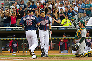 Minnesota Twins left fielder Josh Willingham is congratulated by teammate Justin Morneau after hitting his 1st of 2 home runs against the Oakland Athletics on July 13, 2012 at Target Field in Minneapolis, Minnesota.  The Athletics defeated the Twins 6 to 3.  © 2012 Ben Krause